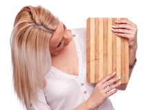 Blonde holding chopping board Royalty Free Stock Image