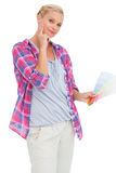 Blonde holding color charts and picking colour Royalty Free Stock Photo