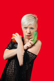 Blonde holding cucumber and tomato Stock Image