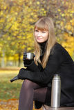 Blonde holding cup Stock Photos