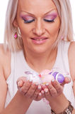 Blonde holding Easter eggs Stock Images
