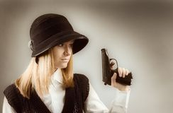 Blonde holding a gun Royalty Free Stock Photo