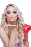 Blonde holding heart and sending kiss Stock Image