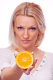 Blonde holding an orange Royalty Free Stock Photography