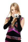 Blonde holding a photo camera. Isolated Royalty Free Stock Photos