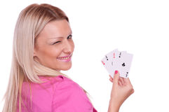 Blonde holding a poker and winks Stock Image