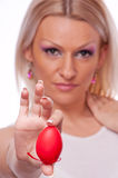 Blonde holding red Easter egg Stock Images