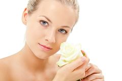 Blonde holding rose flower Royalty Free Stock Image