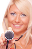 Blonde holding stethoscope Royalty Free Stock Images