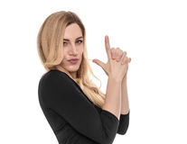 Blonde holds an impromptu pistol in her hands. Royalty Free Stock Photography