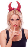 Blonde with horns making a hush gesture Royalty Free Stock Photography