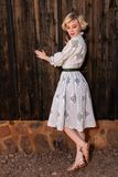 Blonde in a housedress Stock Photo