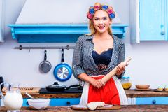 Housewife with dough and rolling pin Royalty Free Stock Photo