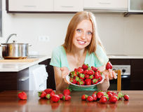 Blonde housewife with fresh strawberries Royalty Free Stock Photo