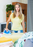Blonde housewife ironing with iron Royalty Free Stock Image