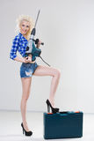 Blonde with industrial hammer. light background Royalty Free Stock Photo