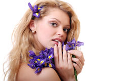 Blonde with iris flowers Stock Photo