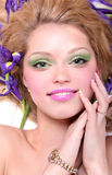 Blonde in iris flowers Stock Image