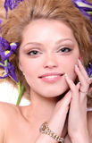 Blonde with iris flowers Stock Images