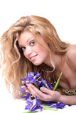 Blonde with iris flowers Stock Image