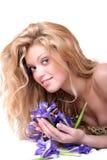 Blonde with iris flowers Stock Image