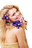 Blonde with iris flowers Royalty Free Stock Photos