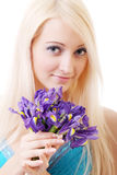Blonde with iris flowers Royalty Free Stock Images