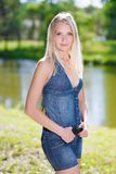 Blonde in jeans clothes Stock Photos