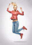 Blonde in jeans jumping Stock Photos