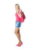 Blonde jonge vrouw in rood met rode zak Royalty-vrije Stock Foto