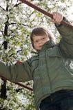 Blonde jongen bij speelplaats royalty-vrije stock afbeeldingen