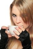 Blonde joven hermoso con una taza de té. Aislado Fotografía de archivo
