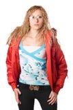 Blonde joven que desgasta la chaqueta roja Fotografía de archivo libre de regalías