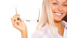 Blonde jugendlich Holdingbrillen Lizenzfreie Stockfotos