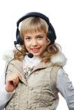 Blonde Jugendliche in den Kopfhörern Stockbild