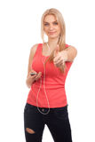 Blonde Jugendliche hören Musik Lizenzfreie Stockbilder