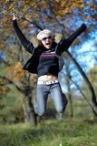 Blonde jumping on the background of autumn nature Stock Images