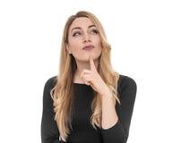 Blonde junge Frau, die seitlich in der Aufregung schaut Stockbilder