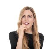 Blonde junge Frau, die seitlich in der Aufregung schaut Lizenzfreies Stockfoto