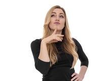 Blonde junge Frau, die seitlich in der Aufregung schaut Lizenzfreies Stockbild