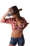 Blonde junge Frau im Cowboyhut Stockfotos
