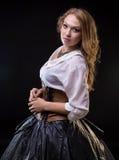 Blonde junge Frau im Fantasiekleid Lizenzfreie Stockfotos
