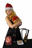Blonde junge Frau mit Geschenktasche Stockbilder