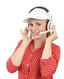 Blonde junge Frau mit Kopfhörer und weißer Kappe Lizenzfreie Stockbilder