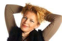 Blonde kaukasische Frau mit blauen Augen Stockfotografie
