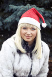 Blonde in Kerstmis GLB en witte furcoat Stock Foto