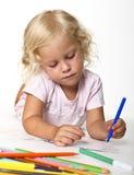 Blonde kid drawing Stock Photo