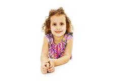 Blonde kid little student girl portrait smiling on a desk Stock Images