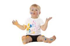 Blonde Kinderfarbenspiele Stockbild