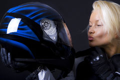 Blonde kissing helmet Royalty Free Stock Photos